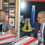 Dr. Filippo Lanaro (left), managing director, Lawer S.p.A.; and Erwin J. Holbein, president, Symtech Inc.