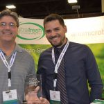 Rich Kenney (left), U.S. national representative; and Lucas Moraes, sales manager, Ultra Fresh/Thomson Research Associates, winner of an IFAI Show Stopper Award.