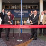 Executives with InPrint USA and ICE USA cut a ribbon to officially open the collocated events