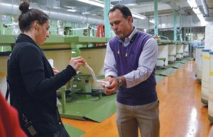 Jim Hopkins, director of sales, Hamrick Mills, demonstrated how twist turns sliver into a yarn with assistance from Dorota Arcentales, fabric manager, PVH Corp.