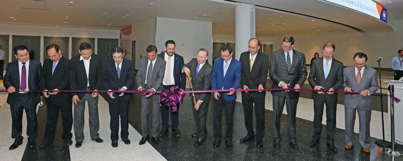 INDA President Dave Rousse (center, holding scissors), led a ribbon cutting ceremony — that was attended by leaders from the global nonwovens industry associations — to open IDEA®2019 as it returned to its usual Miami Beach Convention Center location.