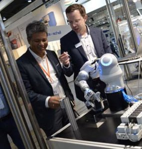 Bernhard Wolz (right), demonstrating Festo's BionicCobot